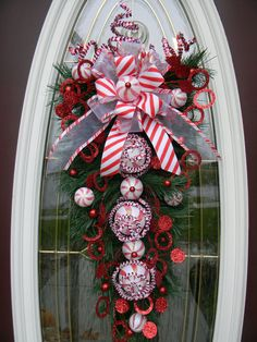 "Christmas Vertical Teardrop Holiday Door Swag..""Peppermint Swirls"" RESERVED for deliea3. $70.00, via Etsy."