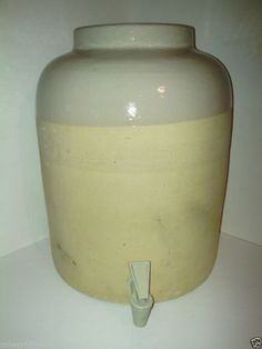 Vintage water crock missing glass top, which supplied water.