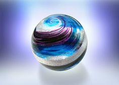 Seattle- based company Artful Ashes is helping loved ones during the grieving process by creating unique glass memorials for those who have passed away.  Through the use of art glass blowing, Artful Ashes collects one tablespoon of your loved one's ashes to include them in a glass orb and or heart.