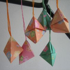 """This origami model is the PERFECT container for a small gift of asst. candy or other items!  I used 8.5"""" or 10"""" square cardstock paper at Christmas, and it got a lot of rave reviews from the recipients."""