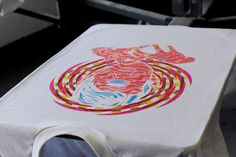 Process shot of the 4 colour CMYK t-shirt being screen printed for competition winner Samuel B. Thorne.