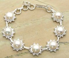 17.50ctw Genuine Pearl & .925 Sterling Silver Plated Brass Bracelet (SJHB0010PEARL) #silverbracelets #braceletsilver #braceletdesigns #sterlingsilverbracelets #silverbraceletsforwomen #braceletsformen #sterlingsilvercharmbracelet #bracelet #personalizedbracelets #gemstonebracelets #handmadebracelets #silvercharmbracelet Buy Now: http://www.sterlingsilverjewelry.tv/genuine-pearl-silver-plated-brass-link-bracelet-sjhb0010pearl.html