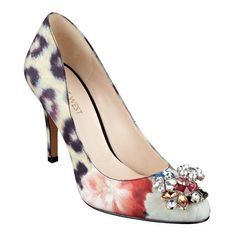 """Sparkle, sparkle! Topped with glittery rocks, the round toe pump morphs from a daytime staple to an evening dazzler. Multicolor jewel. Padded footbed for all-day comfort. Leather upper. Man-made lining and sole. Imported. 3 1/2"""" high heels."""