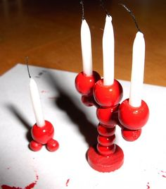 Nukkekodin hengetär (no translation needed - glue and beads! Candles can be tightly rolled strips of paper or snake-rolled baking or air-dried clay, or toothpicks. kj)