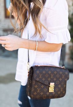 #spring #outfits White Blouse + Brown Leather Shoulder Bag + Navy Ripped Skinny Jeans