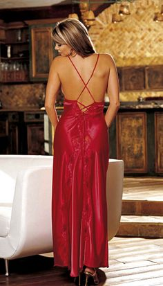 JevelLingerie.com Charmeuse & Lace Long Gown      This elegant gown has lace trimmed cups, a low back  with criss-cross tie shoulder straps that tie down to a  flowing train of scalloped lace and charmeuse. This is a  beautiful choice for the wedding night or honeymoon.  Available Colors: Black, White, Electric Blue, Red.    Available Sizes: Small, Medium, Large, X-Large. Plus  Sizes also available.    Price: $ 55.00