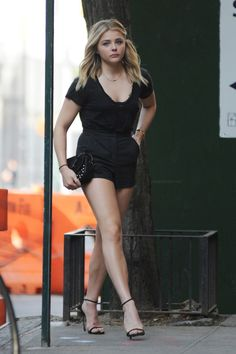 Chloe Grace Moretz paraded her sexy legs around NYC in hot little black shorts and stylish ankle strap high heels. Nice to see her out and about showing off her lovely legs. Chloë Grace Moretz, Beauté Blonde, Sexy Legs And Heels, Great Legs, Perfect Legs, Beautiful Legs, Simply Beautiful, Beautiful Celebrities, Famous Celebrities