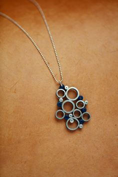 A tutorial for making this easy Blue Bubbles Pendant is in The Art of Quilling Paper Jewelry.