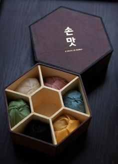 """A Taste of Korea: Korean Food Gift Sets. On the top of the box, the hangul, 손맛, literally means """"hand taste,"""" but the idea is that the hands can enhance the flavor of a dish"""