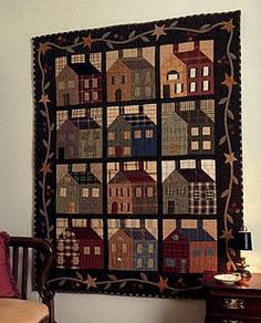 I have a quilt very similar to this one. Same houses just much smaller. And the boarder on mine is just plain green. I need to get it out and have it cleaned. I forgot how much I loved it.