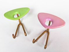 A pair of quirky, retro hangers form 50s Italy. These two hooks come in pastel colors- a lovely green and soothing baby pink! The shape is