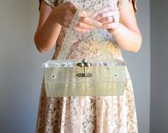Vintage 1950s Clear Lucite Box Purse Charles by AthertonsVintage. $122.00 USD, via Etsy.