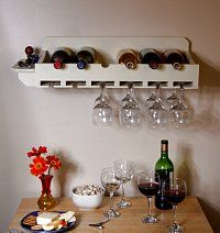 Wall-Mounted Wine Rack  Holds six wine bottles, 12-18 wine glasses  Small shelf on the end  Includes mounting hardware  Color: Almond  Size: 6 1/2 high, 27 1/2 wide, 10 3/4 deep  $45 plus shipping and handling