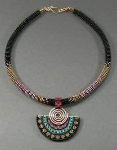 "Necklace |  Joan Babcock.  ""Spiral Fan Collar"" Wrapped seed beads, Pendant of Red Brass and Nylon Cord. Original has been sold.    Price 495.00    Item #J-PC150139"
