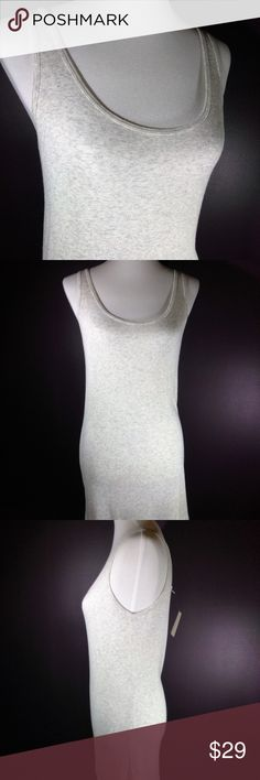 Lovely Vintage cabi Spring 2011 Dream Tank NWT ♥ Versatile vintage cabi Spring 2011 Dream Tank #389 ♥ New w/tag! Dreamy (literally) fabric tank is super soft & makes a perfect go too in summer for extra coverage! Heather grey color is gorgeous ♥ This tank is the perfect addition to your spring wardrobe, it will go with everything!   Fabric: 96% Rayon - 4% Spandex   Garment Care: machine wash cold - flat to dry   ♥ Please visit my closet again soon - lots of excellent deals on minty condition…