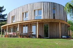 The Nutmeg House, which is shaped like a super ellipse, is an energy efficient home by Barnaby Gunning Architects in the UK