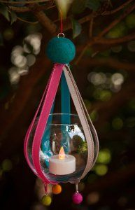 Zipper hanging votive. I love this idea but i would like to use ribbon instead of zippers and make it look a bit different.