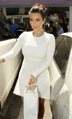 Kim Kardashian Photo - The Kardashian Sisters Buy a Fish Tank