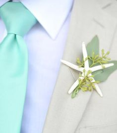 Boutonniere with a small finger starfish and eucalyptus berries.