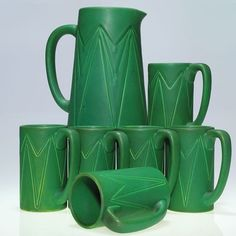 Rookwood 1905 Pitcher and 6 mugs, mat green glaze : Lot 734