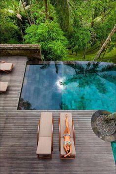 Wood decking around infinity pool | Como Shambhala Resort (Bali)