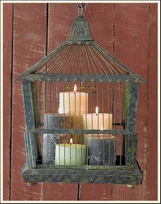 verdigris bird cage with candles