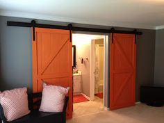 Sliding barn door, can use door and hanging sytem from barn.  I lived in a house once that had a single barn door hung like this.  Beautiful and practical.  Can do with doors too.  I bought a nice, hardwood door from Menards (10.00).  As soon as I find the hanging system for cheap it is going up in the laundry room.