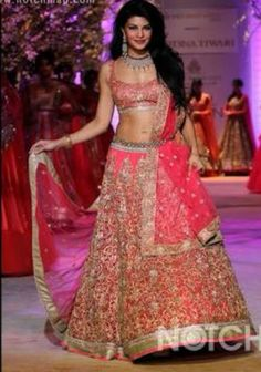 Bollywood actor, Jacqueline Fernandez was the showstopper and star attraction at Jyotsna Tiwari's show during the Aamby Valley India Bridal Fashion Week (IBFW) in Mumbai, India on November Pink Lehenga, Lehenga Style, Jacqueline Fernandez, Indian Party Wear, Indian Wear, Bollywood Celebrities, Bollywood Fashion, Bollywood Actress, Bridal Outfits