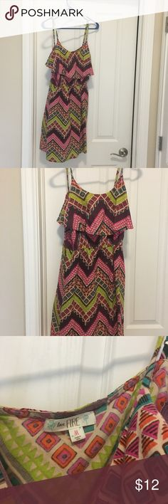Pretty printed dress with ruffled top layer Super colorful knee length dress with pretty ruffle on top! Take your sassy self anywhere with this unique frock! Dress up with wedges or heels or make it more casual with some flats or ballet slippers. Dresses Midi