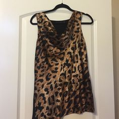 The Limited- Leopard tank Cowl neck tank can be dressed up or down. Back is black knit. Front is leopard print polyester. No trades please. The Limited Tops Blouses