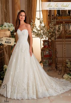 "Dress Style AIEV  CHANTILLY AND EMBROIDERED LACE ON TULLE BALL GOWN WITH SCALLOPED HEMLINE  Available in Three Lengths: 55"", 58"", 61"".  Colors Available: White, Ivory, Ivory/Champagne"