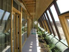 An atrium in the new generation earthships  - I love the idea of this home, but I wish It was more refined in its look, although it does have lovely rustic feel.