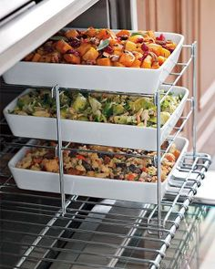 PERFECT for holidays where I'm always stressing that this will be cold while that gets done!   Three Tiered Oven Rack: When oven space is at a premium, this stacked stainless-steel rack saves the day. Place it on one half of an oven rack and bake several side dishes while the main fare cooks alongside. It is made in the USA and folds flat for convenient storage