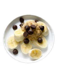½ small banana, sliced, topped with 1 Tbsp peanut butter and sprinkled with 2 tsp dark chocolate chips  192 calories, 11 g fat