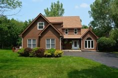 PRIVATE WOODED OASIS- BRIGHT & SUNNY LIVING/DINING ROOM W/ VAULTED CEILINGS HARDWOOD FLOOR & 3-WAY FIREPLACE WELCOMES YOU HOME.
