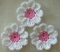 This listing is for 12 white cotton thread crochet flowers with French Rose centers.    Add to your scrapbook pages, greeting cards, clothes,