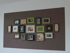 Photo Wall - like the idea of painting a different color behind the grouping...