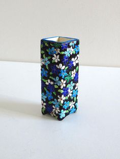Small cloisonne vase from Gien manufacture (France). N°134, T mark. Diamond shape, blue flowers decor on black backgroud. Good condition, just note a