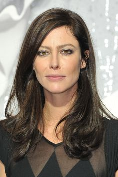 Anna Mouglalis attends the Chanel Ready to Wear Spring / Summer 2012 show during Paris Fashion Week at Grand Palais on October 4, 2011 in Paris, France.