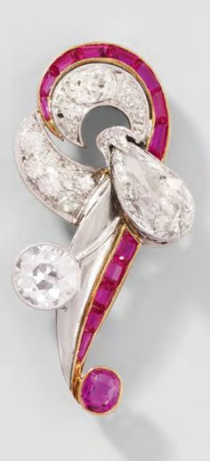 An Art Deco yellow and white gold, diamond and synthetic ruby brooch, circa 1930. 4.8cm long. #ArtDeco