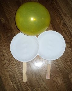 Balloon Ball -- easy and keeps them busy. All you need is 2 paint sticks, 2 paper plates, tape and glue and a balloon. How fun!