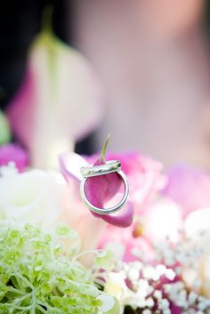 Wedding Rings on the bridal bouquet. photo: www.eyecontact.ca