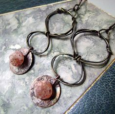 etched metalhoop earringsOrange Sherbet by anvilartifacts on Etsy, $44.00
