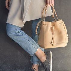 Current favorite look compliments of our buttery soft Mini Bucket in Sand. Fun fact: our tannery uses the best leather hides that are a by-product of the food industry, which enables the hides to be recovered and made into something special rather than going to waste. Our tannery has won numerous awards for ecological responsibility and we're proud to have them as a partner. #mindfullydesigned  #Regram via @vonholzhausen