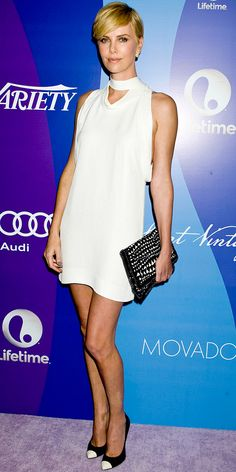 10/07/13: At Variety's Fifth Annual Power of Women event, Charlize Theron rocked a minimalist Stella McCartney LWD with a neck-tie detailing. She styled her dress with black-and-white print Stella McCartney clutch and cap-toe Giuseppe Zanotti pumps. #lookoftheday