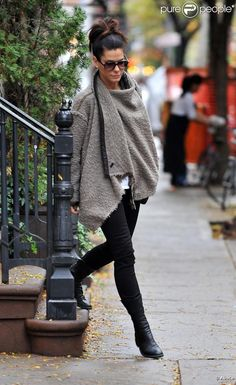 Sandra Bullock is Wearing Grey Shawl, Black Skinny Jeans and Tall Knee High Black Boots.  Hair in an Up-Do Fashion and Sunglasses.  Great for Fall.