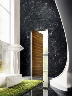 LInvisibileVerticalPivotdoor_TeakVeneeredfinish_openedversion_Apartment_Milan_Italy_invisibledoors