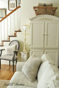 living room... If I paint my armoire similar color of wall it won't look so big?  ?