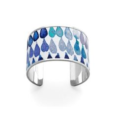Part of our 2015 Spring Summer Collection, the Cleopatra Cuff Bracelet is the must-have statement accessory piece this season. Hand crafted with an inlay of the finest vegetable tanned navy raindrop printed Italian nappa leather and engraved with...