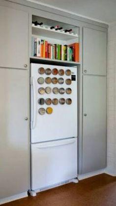 Magnetic Spice Racks On A Refrigerator Door.